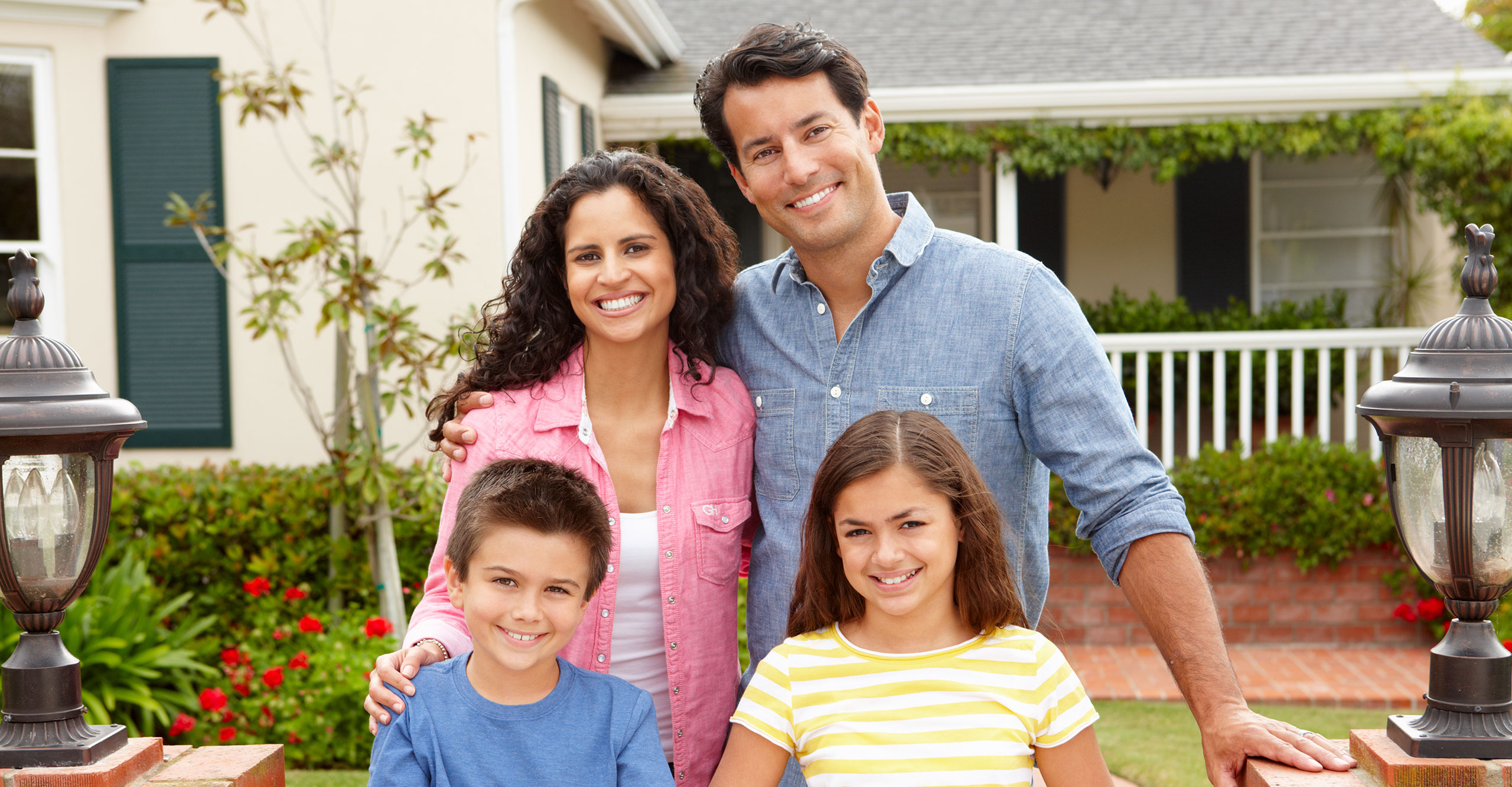 hispanic-family-in-front-of-home