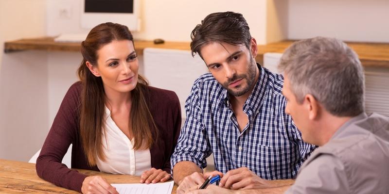 Couple listening intently to Loan Originator