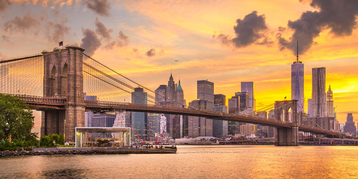 City scape of Brooklyn Bridge at sunset