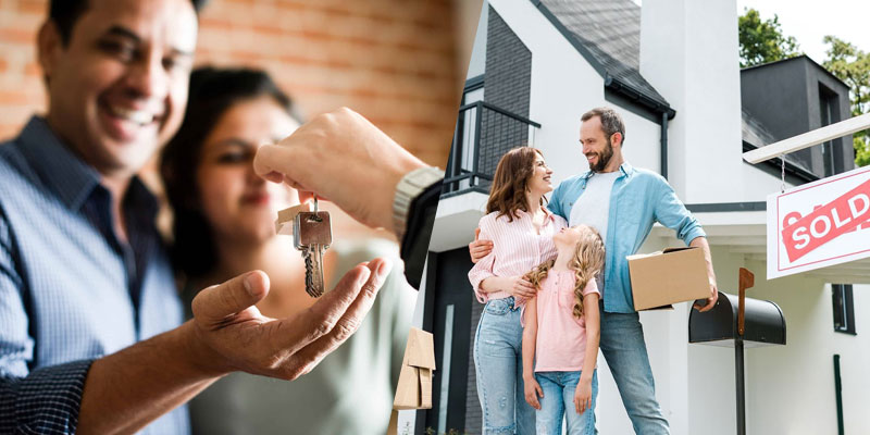 couple receiving keys to new home and family standing in front of sold house