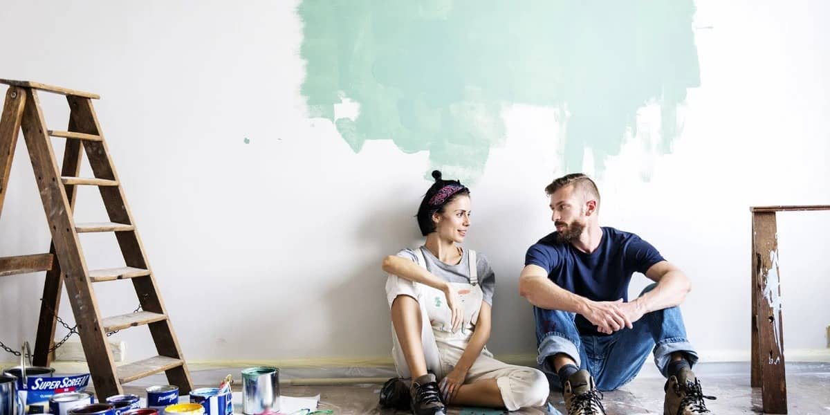 couple-taking-a-break-from-painting-room