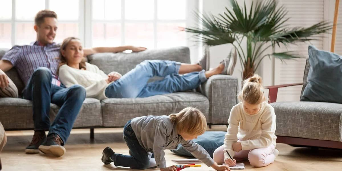 family-in-living-room-with-kids-playing