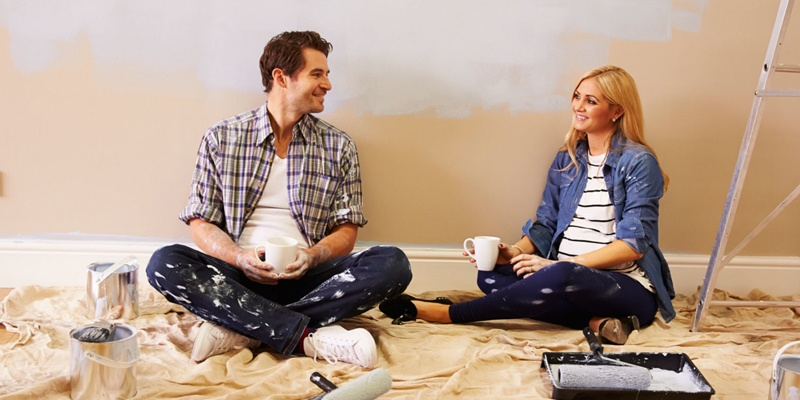 Couple sitting down after day of working on new home
