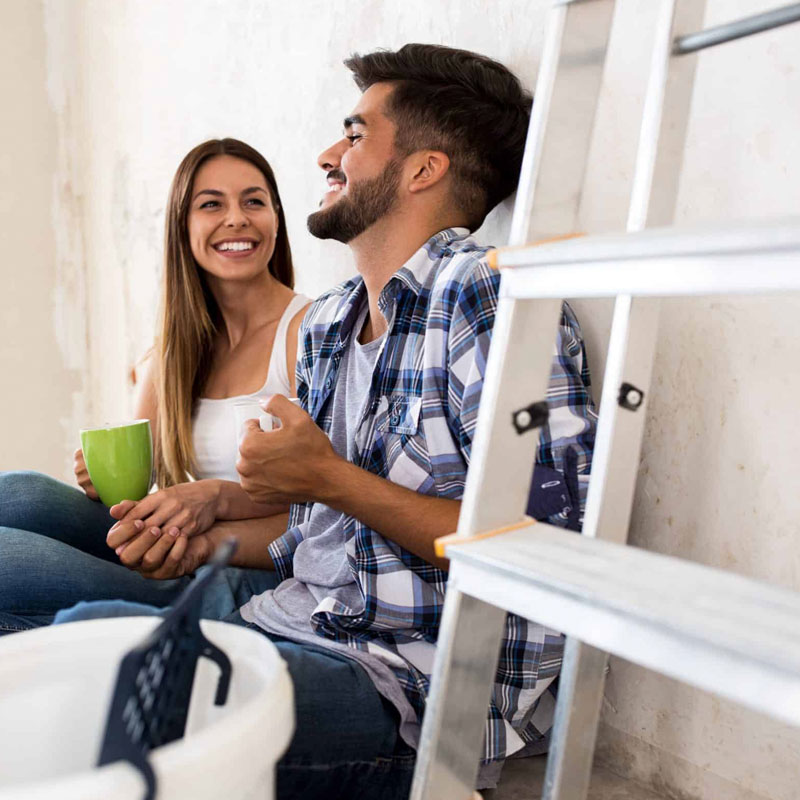 couple-laughing-while-renovating-home