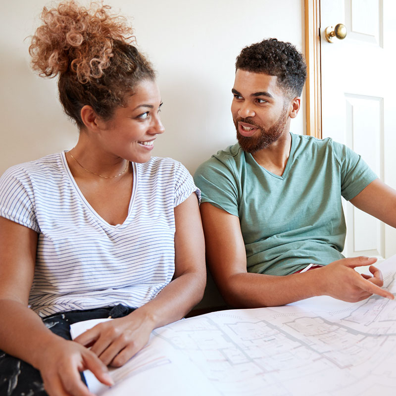 couple-looking-at-renovation-blueprints