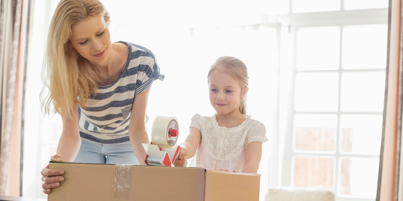 Mother and daughter unpacking boxes