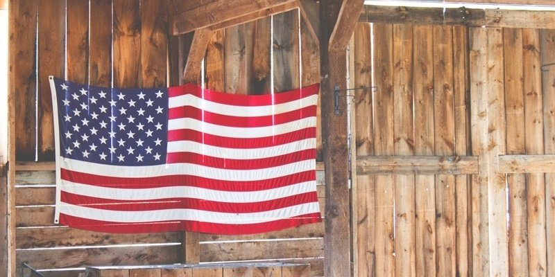 American Flag against Hardwood Barn