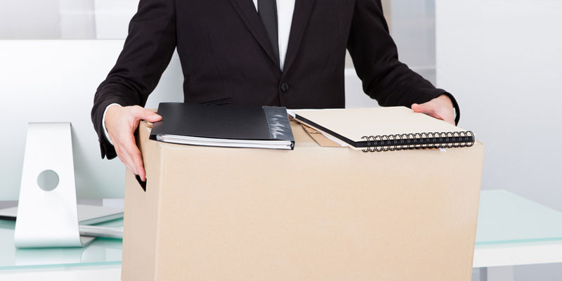 Business man with box and books to move