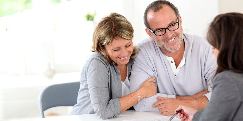 Couple talking to mortgage broker about house