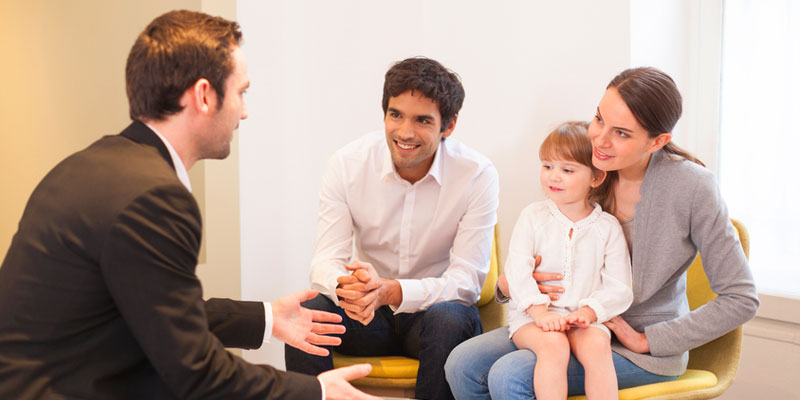 Diverse family with daughter speaking to mortgage broker