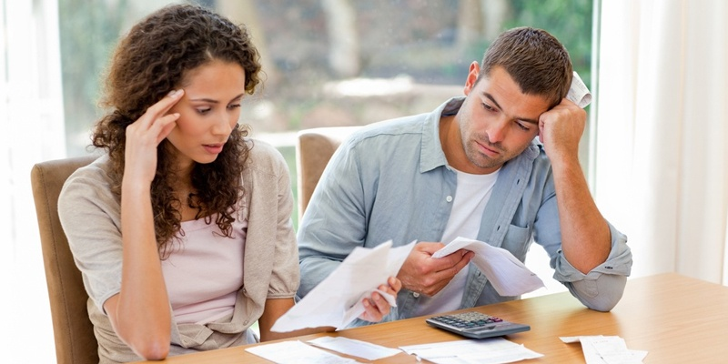 couple stressed while doing taxes