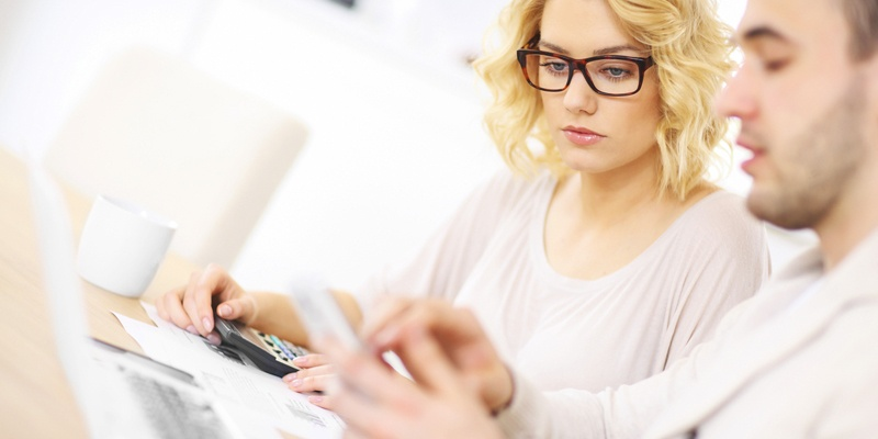 Woman looking and calculating for house purchase